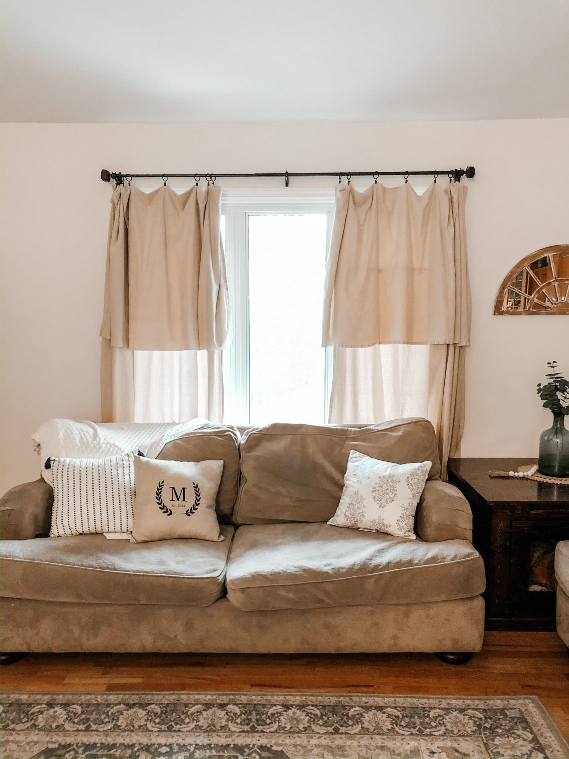 Picture of farmhouse living room decor with no sew drop cloth curtain